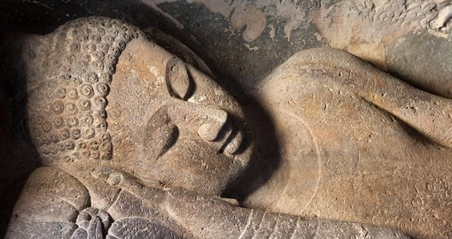 On your Trip to India, marvel in the beauty of the ancient reclining Buddha in the Ajanta Caves