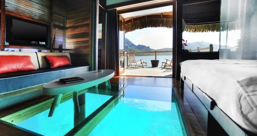 Sit inside your overwater bungalow and enjoy the scenic view of the ocean and mountains during your Trip to Bora Bora.