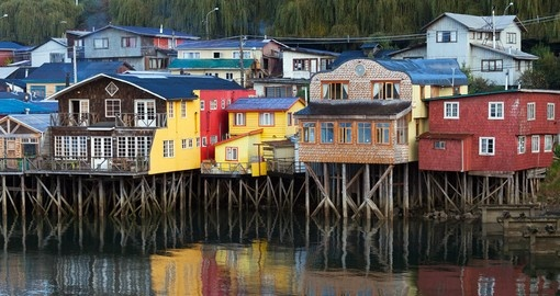 Enjoy views of traditional houses on Chiloe Island on your Chile Tour