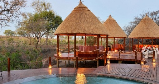 Cool off in the swimming pool at the Hoyo Hoyo Safari Lodge on your South Africa trip.