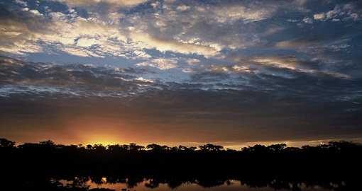 Watch the sunset at the Dulini Leadwood Lodge during your South Africa trip.