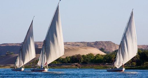Feluccas sailing on the Nile are a great photo opportunity while on Aswan tours.