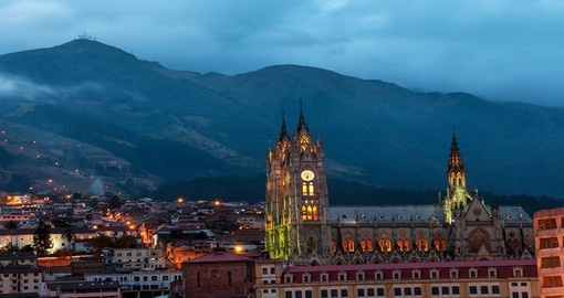 Night time view of the Basilica and old town in Quito