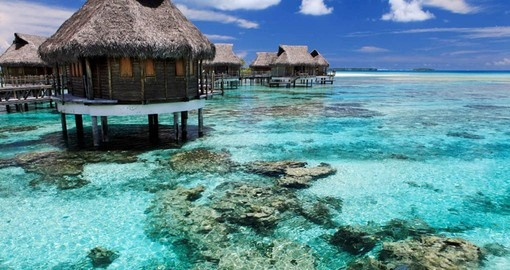 Stay in an overwater Bungalow on Tikehau atoll on your Tahiti Vacation