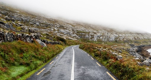 Road disappearing into the mist on the Wild Atlantic Way in Ireland