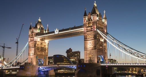 Cross the magnificent Tower Bridge, best enjoyed at night, on you London Vacation