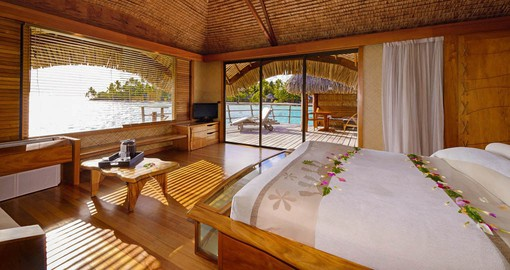 The Taha'a Overwater Suite offers the unique feeling of floating above the crystal-clear lagoon