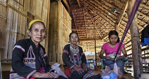 Visit Karen Long Neck hill tribes and the women in their traditional costumes as part of your Thailand Vacation