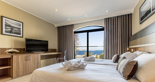 Relax in your spacious Sea View Room at the Dolmen Resort on your Malta vacation