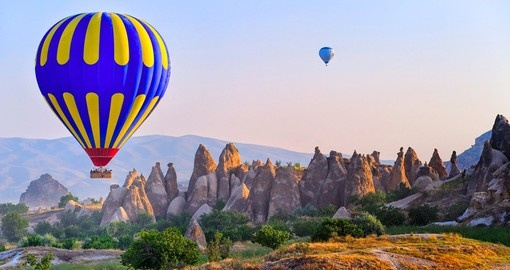 View the beautiful rock landscape in Cappadocia during your Turkey trip.