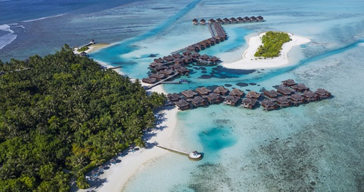 Enjoy the Anantara Veli Resort which extends onto the ocean on your Trip to Maldives