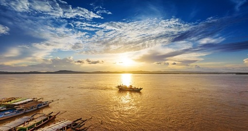 Watch the sunset in the Irrawaddy River in Myanmar during your Myanmar Tour.