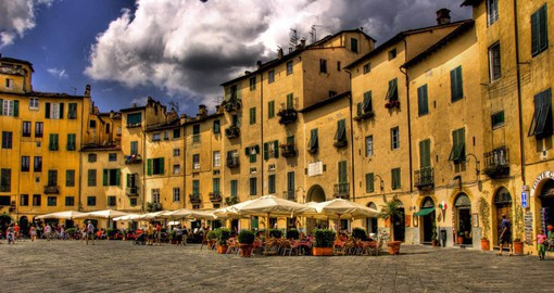 Visit the medieval square in the Tuscan city of Lucca