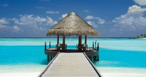 Relax in the shade and look out into the blue ocean while you relax on your Maldives Vacation
