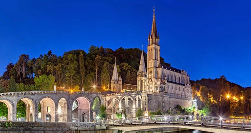 Lying in the foothills of the Pyrenees, Lourdes became famous of the 1858 apparition of the Virgin Mary