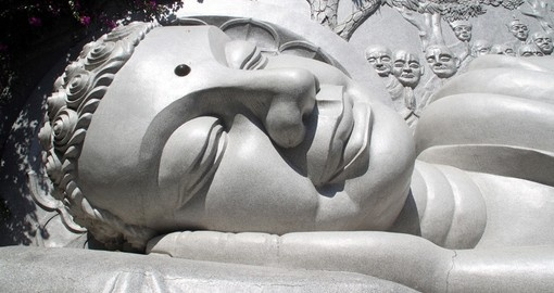 A sleeping white Buddha on a hill overlooking Nha Trang