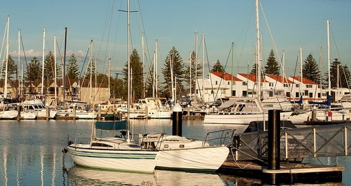 Evening sunshine on a yacht marina in Adelaide during your next trip to Australia.