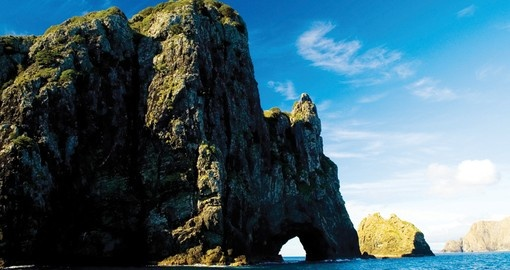Walk along the beach in the Bay and marvel at the ancient rock formations on your New Zealand Vacations
