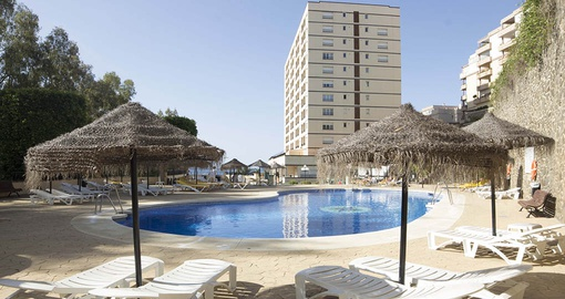 Relax poolside at First Flatotel International on your Spain Tour