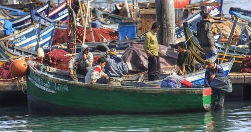 Fishermen in the harbour of Agadir makes for a great photo opportunity on all Morocco vacations.