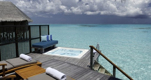 Relax in your personal pool in your Water Villa that overlooks the ocean on your Trip to Maldives