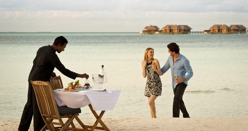 A romantic dinner on the beach can be arranged when booking one of our Maldives vacation packages