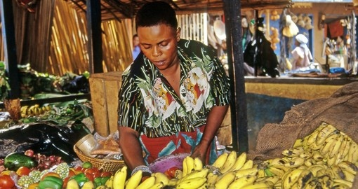 A vendor in the markets of Kampala