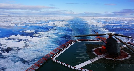 Take a helicopter tour from the ship and soar above the snow capped landscape on one of your Arctic Trips