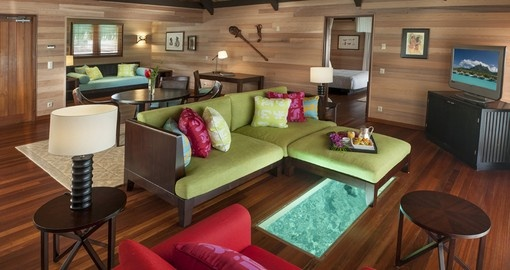 Lounge in the spacious rooms at the St. Regis Bora Bora during your Trip to Tahiti.