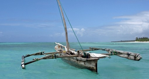 Old wooden arabian dhow in the Indian Ocean near Zanzibar