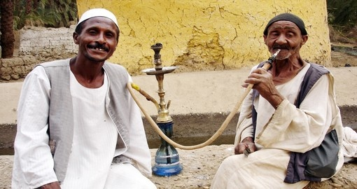 Men smoke from a shisha pipe