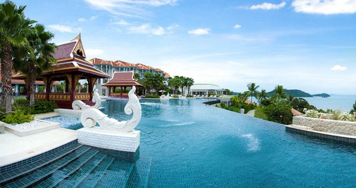 Enjoy a dip in the pool at the Amatara Wellness Resort during your Thailand vacation.