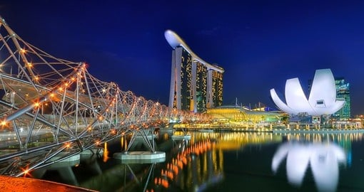Enjoy the lights and unique architecture around the main waterfront strip in Singapore on your Singapore Vacation