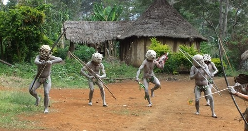 Mudmen warriors dancing