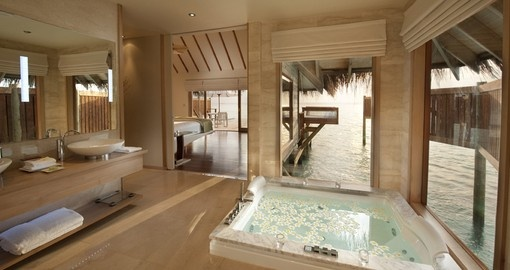 Sit in your luxurious bath that faces the pacific ocean in your personal villa on your Maldives Vacation