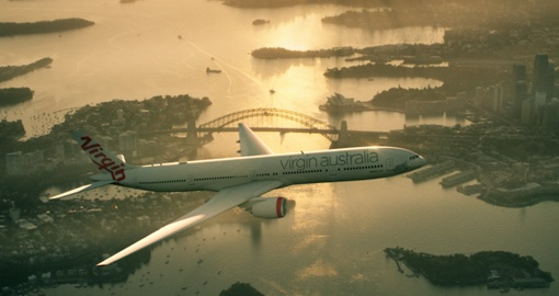 Virgin Australia 777 aircraft flying over Sydney Harbor
