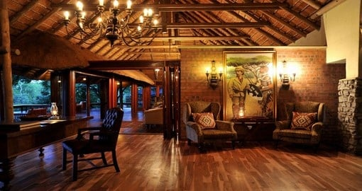 Relax in the lounge at Imbali Safari Lodge during your South Africa vacation.