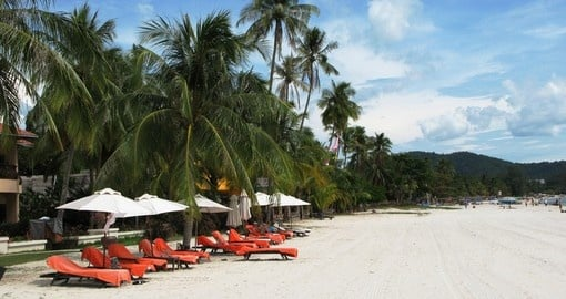 Enjoy comfort and relaxation on one of Langkawi's white sand beaches on your trip to Malaysia