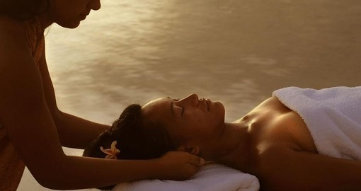 Have a relaxing massage outdoors on your next trip to Tahiti.