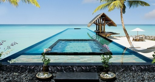 Sit in the infinity pool at the One&Only Reethi Rah and experience true relaxation on your Maldives Vacation