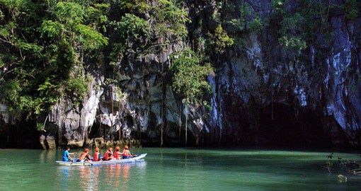 Sail into a Cave on the St. Paul's Underground River, one of the 7 new wonders of nature on your Philippines Vacation.