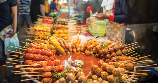 Enjoy traditional snacks on your Thailand tour