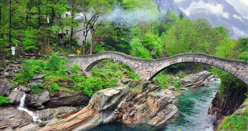 "Completed 400 years ago the ""Ponte dei Salti"" stone bridge soars over the turquoise Verzasca"