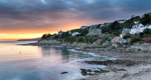 Experinec dusk over Tavern beach at St Mawes near Falmouth in Cornwall during your next England vacations.