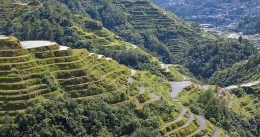 Walk along the hillside and explore the UNESCO World Heritage site known as the Banaue rice terraces on your Philippines Vacation