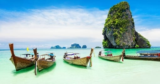 Check out the traditional boats that line the beaches in Phuket on your Thailand Vacation