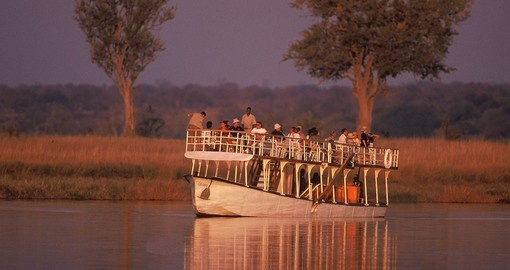 Take a cruise on the Chobe River and enjoy beautiful view on your next Zimbabwe vacations.