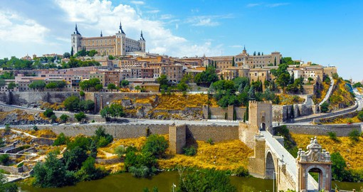 Sitting above the plains of Castilla-La Mancha in central Spain is the ancient city of Toledo