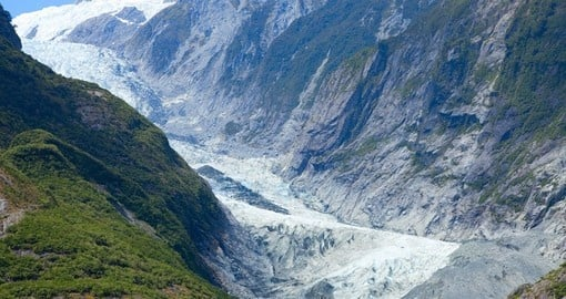 Trek up the mountainside on one of your New Zealand Tours and marvel in the presence of Franz Josef Glacier.