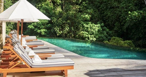 Include some relaxing time by the Four Seasons Sayan's Pool on your Bali Vacation package